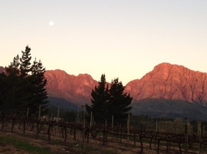 The last of the sunlight and a rising moon over the Hawequas Mountains