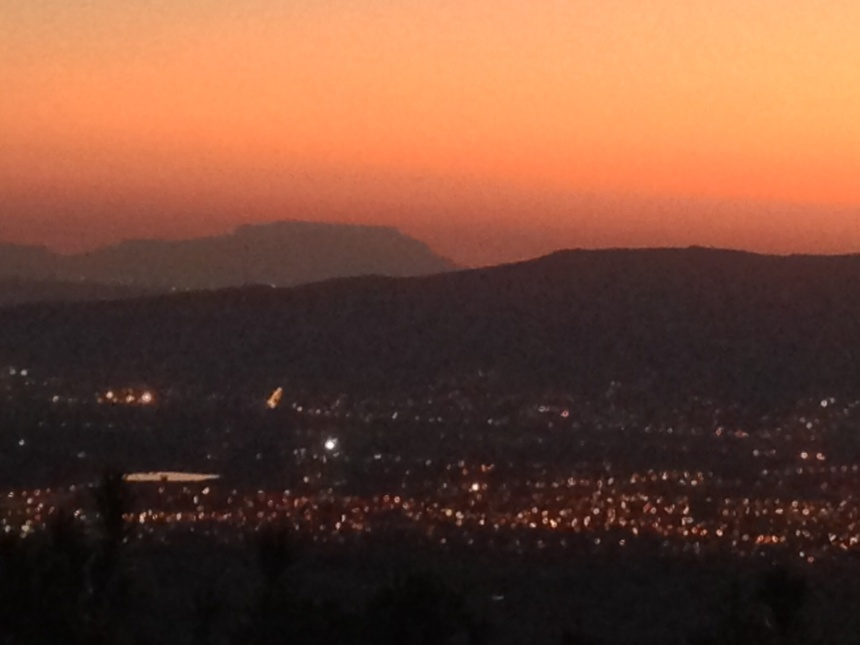 The lights of Paarl below as Table Mountain dominates the evening sky